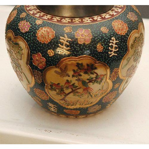 A nicely hand decorated Japanese Satsuma style biscuit or cookie pot with metal handle and lid. Thought to be from the...