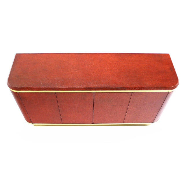 Brick red color grass cloth with brass trim mid-century modern credenza possibly designed by Karl Springer.