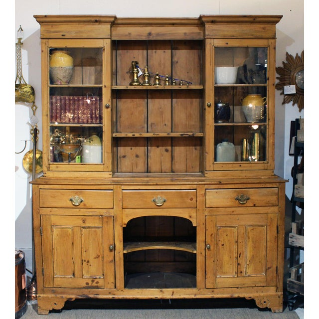 Wonderful English pine dresser with three drawers and glass cabinets.