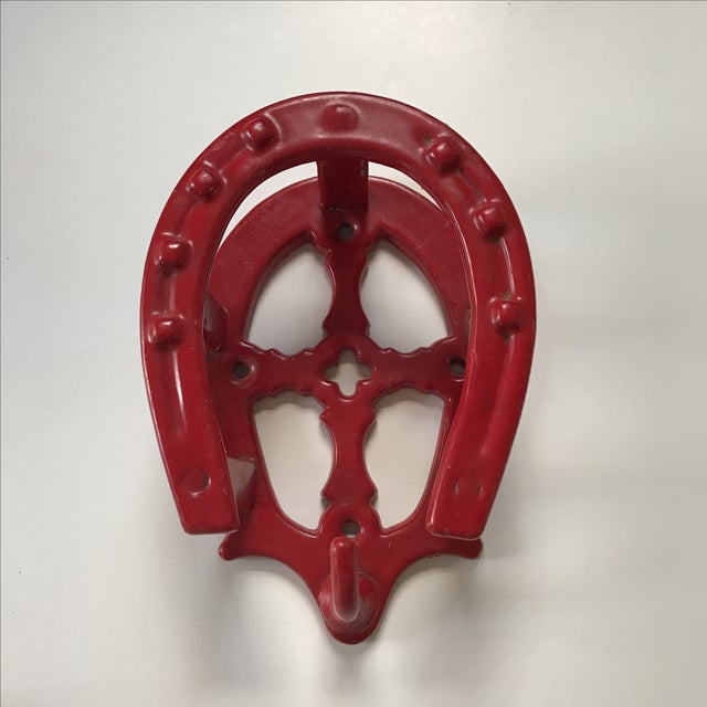 Great looking heavy iron hook which would hold a hat and a coat or bag. It's bright red color brings a contemporary looks...
