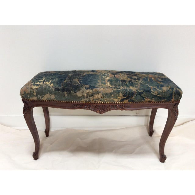 Authentic Flemish tapestry covered antique French Style bench. This is great as an accent piece in a room. The tapestry is...