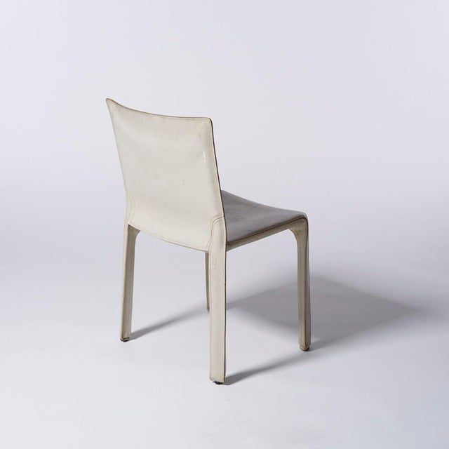 White leather Cab side chair designed by Mario Bellini for Cassina circa 1970s-80s Chair has wear, some discoloration, and...