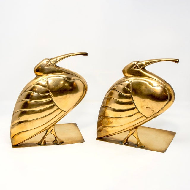 Circa 1980s pair of brass bookends with plump herons or egrets. Sold and priced as a pair. Unknown maker. DEALER...