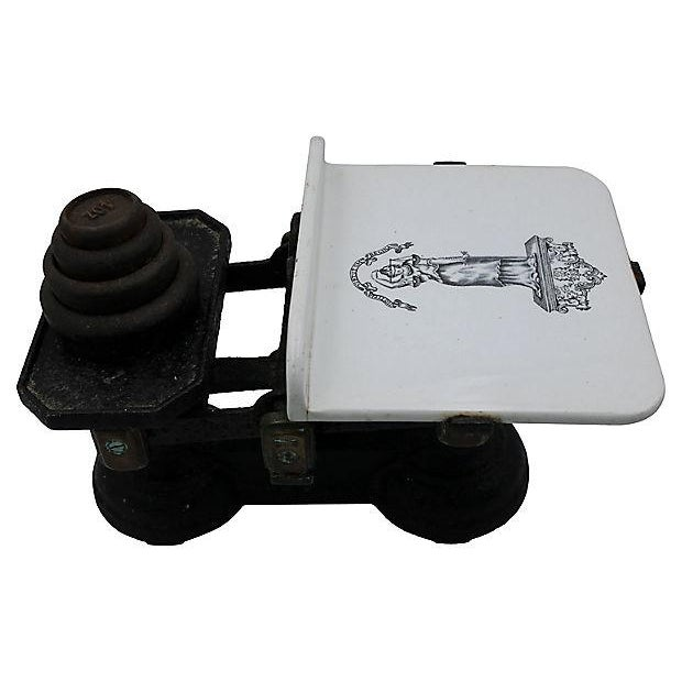 Antique Victorian kitchen scale with ironstone plate. Weights range from 4oz to 2lbs.?? Maker's mark on base. Light wear.