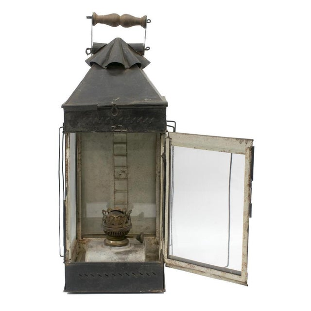 Antique Anglo - Indian iron oil lantern. This lantern features a swing carry handles and interior oil fount. Sheet metal...