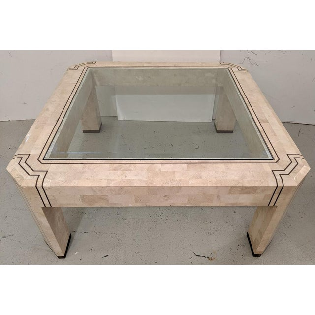 This is a handsome tessellated stone cocktail table, made by Alexvale Furniture, Inc. The table is square, with 45 degree...