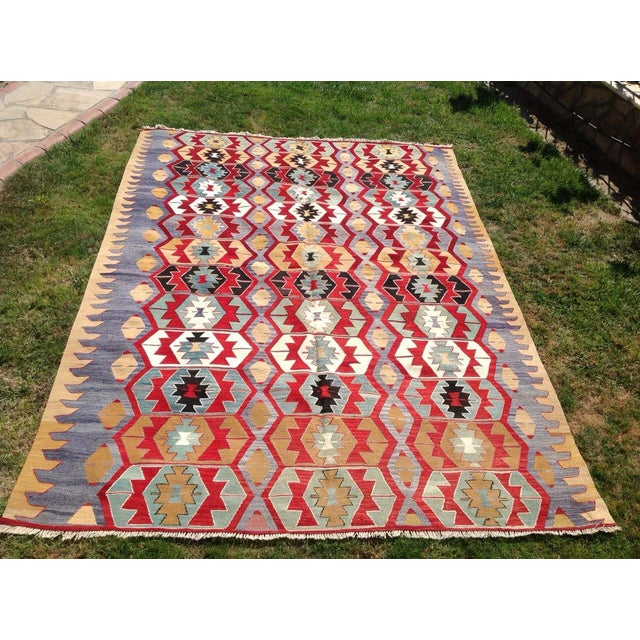 This beautiful vintage handwoven kilim is in fabulous shape. It is approximately 70 years old, handmade of very fine...