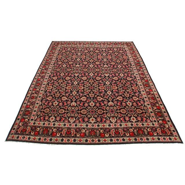 Vintage Hand Knotted Wool Persian Bijar Rug. Floral design. Measures 10′2″ × 12′9″.