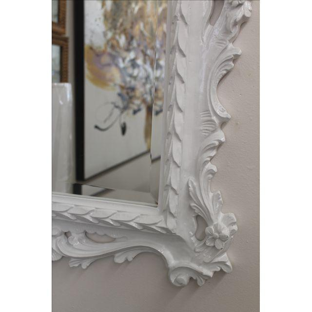 Gorgeous white lacquered mirror in the Chippendale manner.