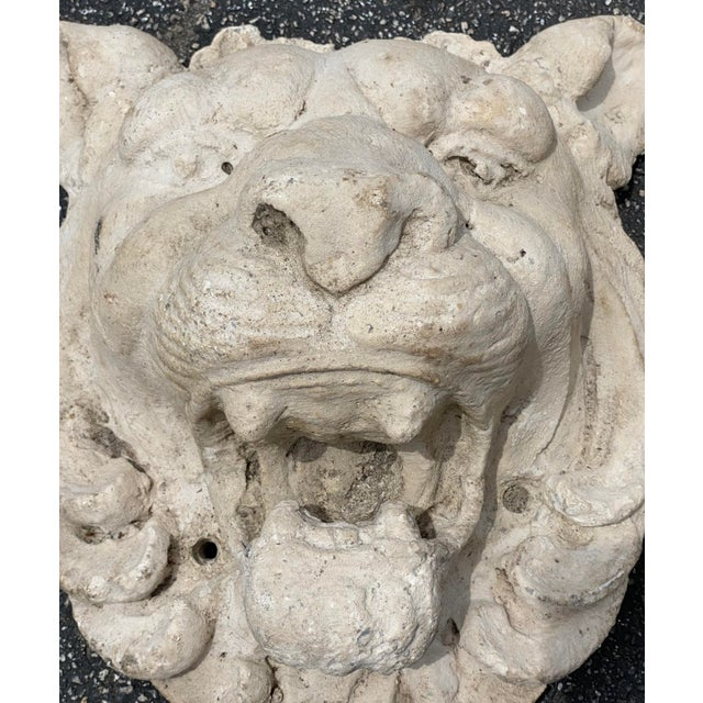 Stunning pair of cast stone lions heads. Great roaring position. Acquired from a Palm Beach estate.
