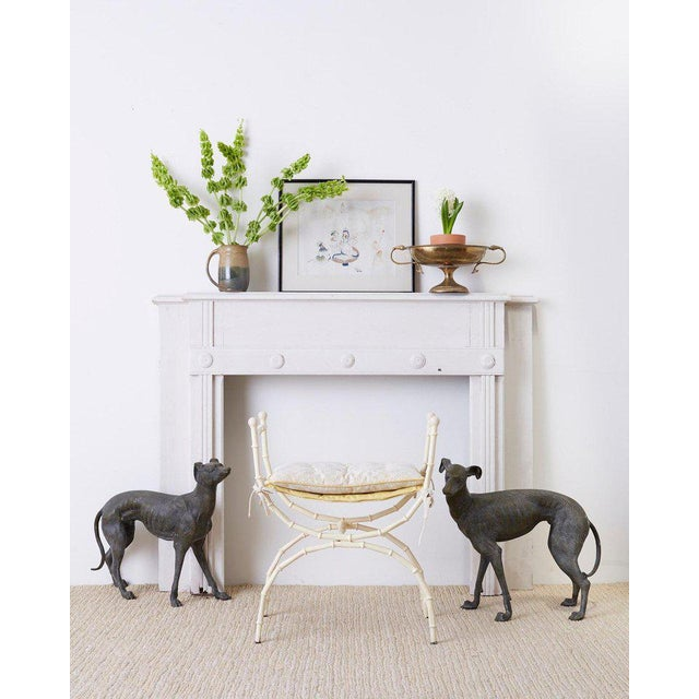 Fantastic pair of patinated bronze whippets or greyhound life-size dog sculptures. Beautifully detailed with textured...