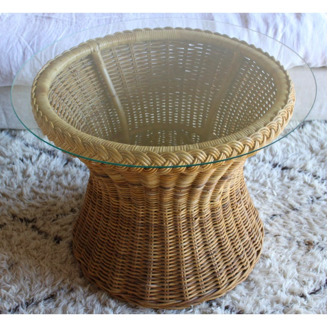 An absolutely fabulous mid century rattan tulip shaped center, side, or cocktail table manufactured by The Wicker Works in...