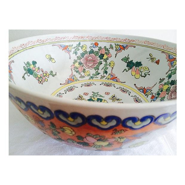 Hand-painted large Chinese pastels and citrus color palette botanical motif cernterpiece bowl. Made in China. Minor wear.
