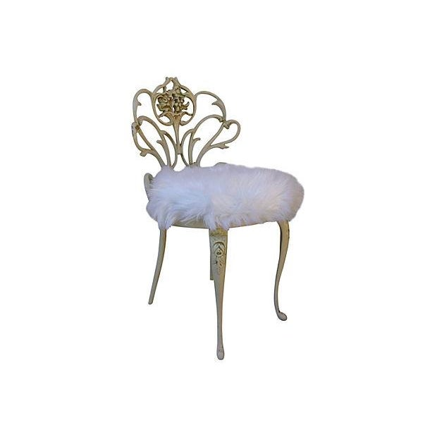 "Metal vanity stool newly upholstered in a beautiful faux-fur textile. Seat, 18""H. Some wear."