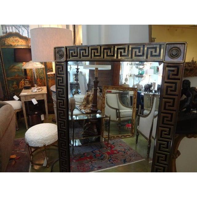 "Large well-made Mid-Century Modern brass Greek key beveled mirror by Mastercraft. Measures: 55.5"" H. This versatile..."