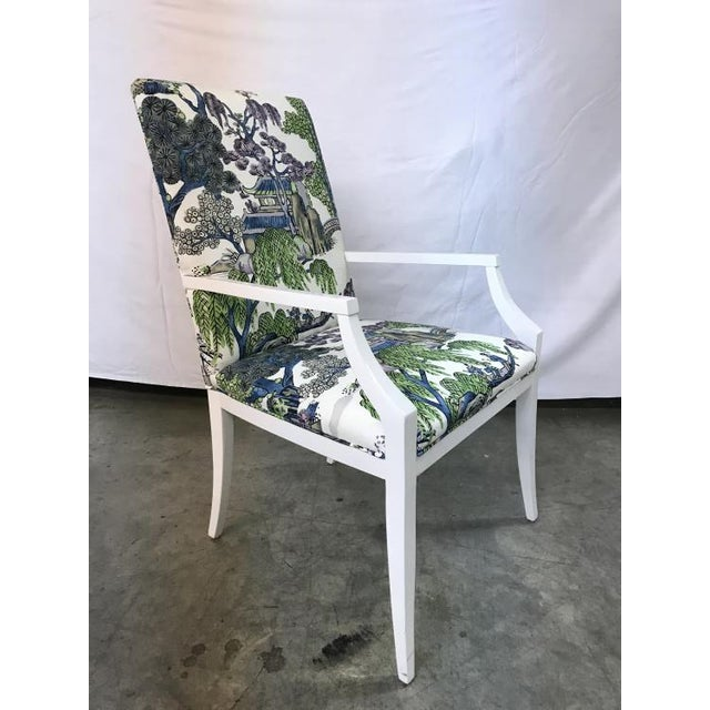 The Crosby Arm Chair is a first quality market sample that features a Blue and Green Patterned Fabric with a White Dove...