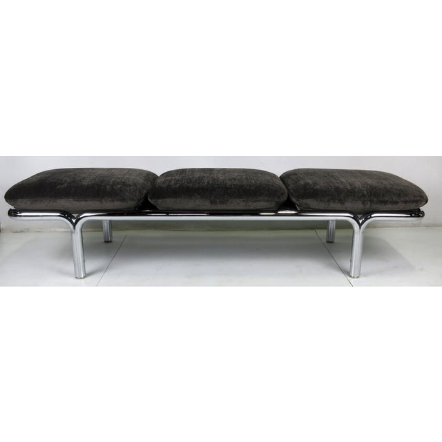 Large-scale chrome gallery bench with three well padded cushions, freshly upholstered in charcoal grey chenille.