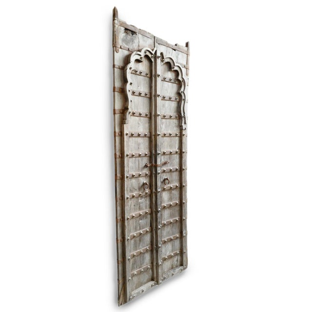 "Tall antique Rajasthan wood and iron door with carved moorish scallop detail. Posts at top are 4""."