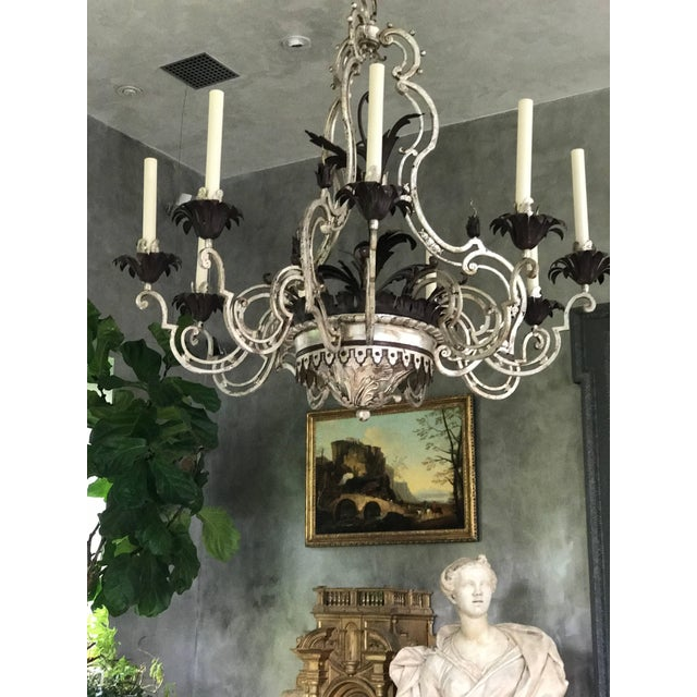 This beautiful wrought iron & tôle nine-arm chandelier was created in the 1940s and inspired by a Louis XV French...