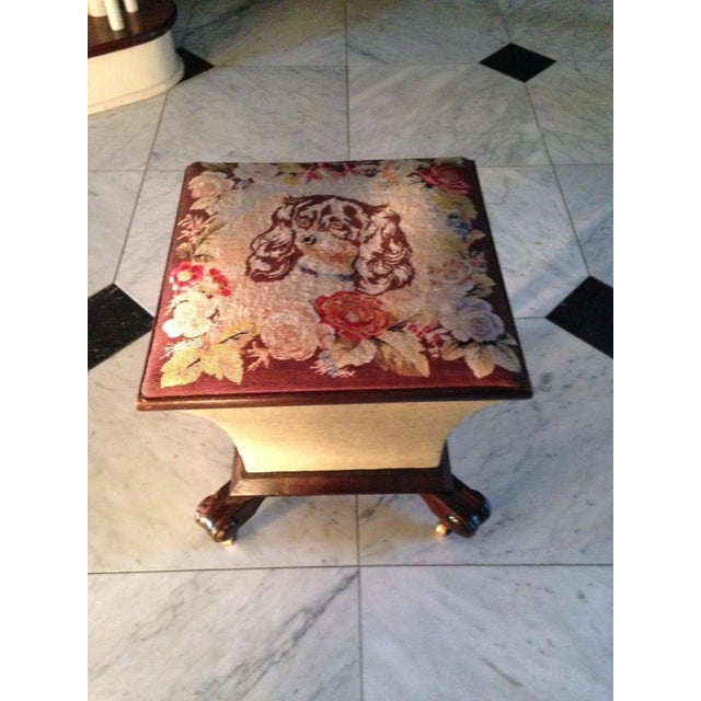 Charming small ottoman with petit point top depicting a King Charles Spaniel surrounded by floral decoration, with a...