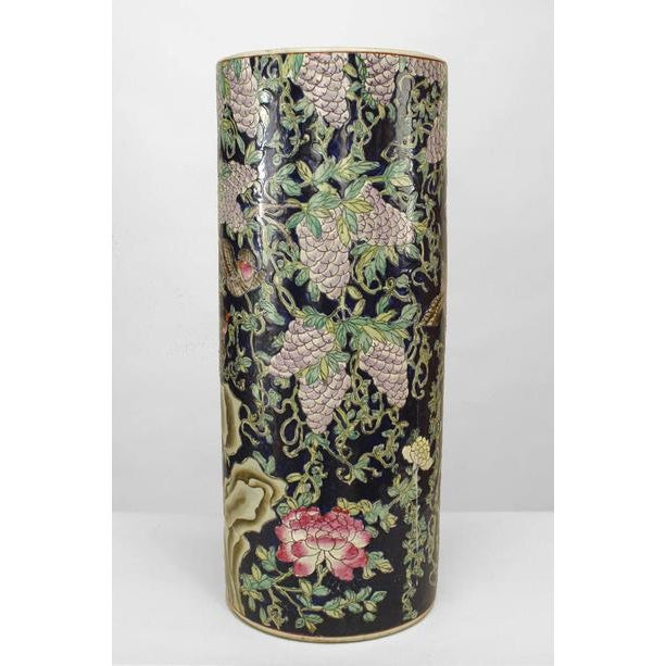Asian Chinese porcelain cylindrical shaped umbrella stand with dark blue, purple & green decoration of birds and flowers...