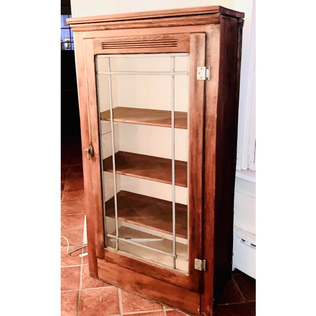 Beautiful three-quarter height oak display cabinet/China cabinet with full panel glass door with Leaded trim and working...