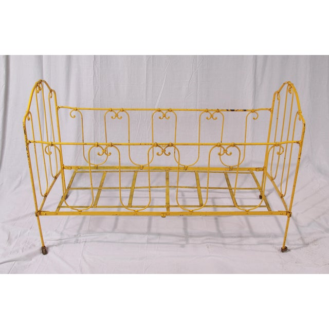 The greatest little vintage daybed/crib, found in the markets of Paris, that could be used in so many ways. As the side...