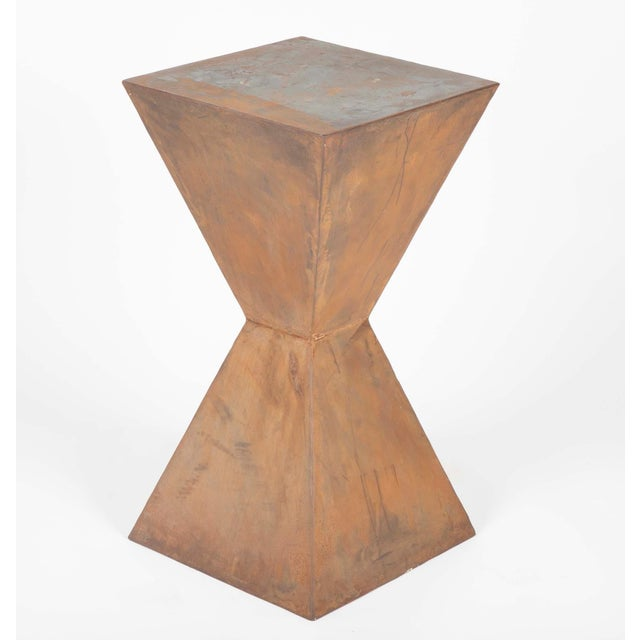 Compelling pair of geometric steel side tables in very much in the style of Constantin Brancusi. With a soft rust colored...