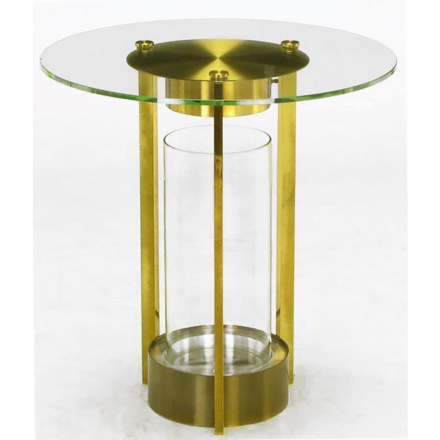 Unusual, yet very elegant, glass and brass end table with three legs, center glass cylinder terrarium and lighting...