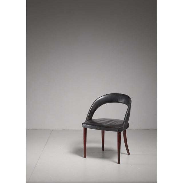 An elegant vanity chair by Danish designer Frode Holm for Illums Bolighus. The chair stands on round, tapering rosewood...