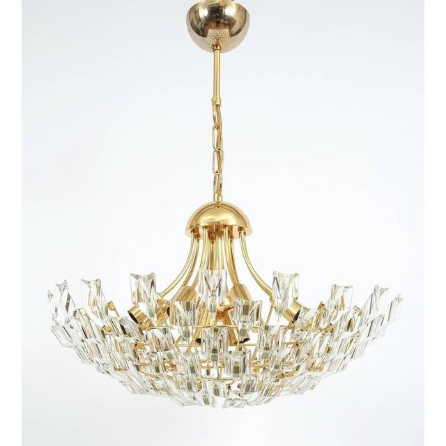 Large glass and brass chandelier by Stilkrone, circa 1970 with gold-plated brass hardware and a multitude of crystals. 12...