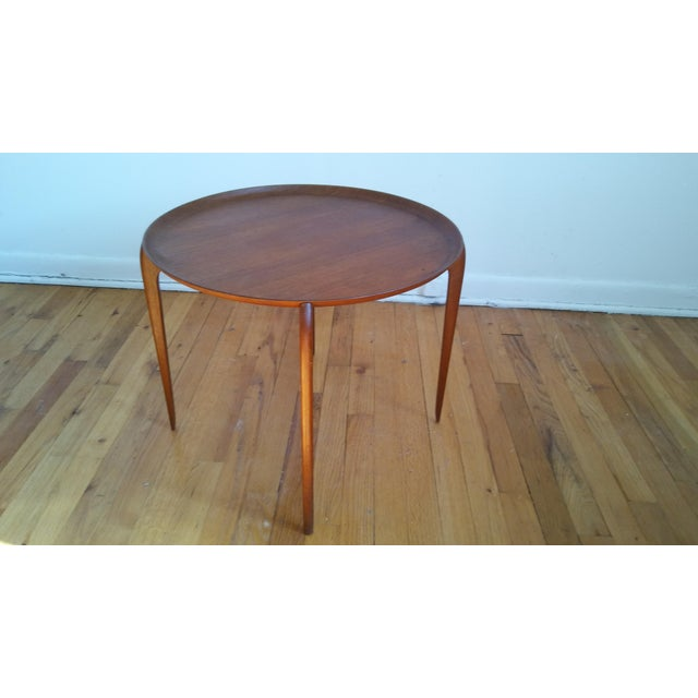 Vintage 1950s Danish tray table with a removable top. The base does not fold up. The legs have a really unique shape. Teak...
