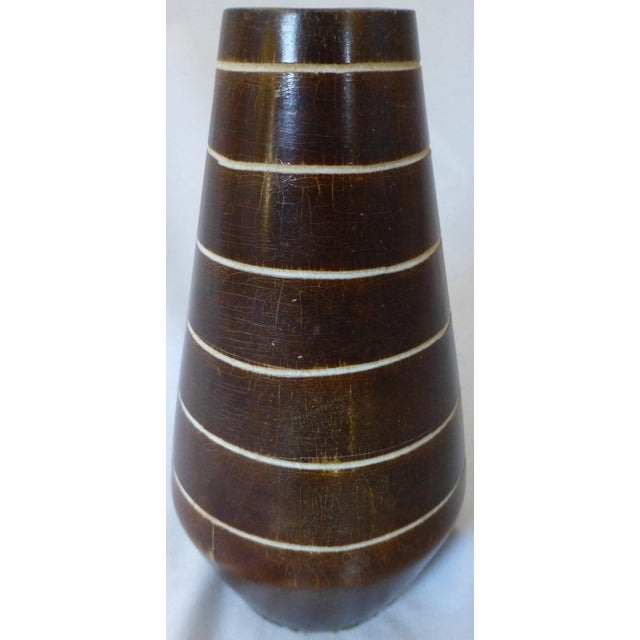 Mid century tiki styled vase, we love the form, and the unique carved spiral line decoration. We would date this one to...