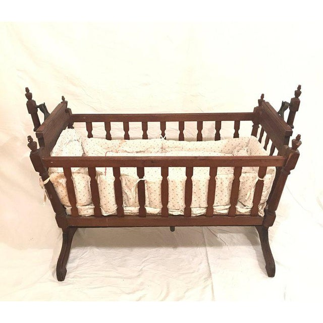 This antique swing crib is not only beautiful and adorable, it is also the perfect way to gently swing and soothe your...