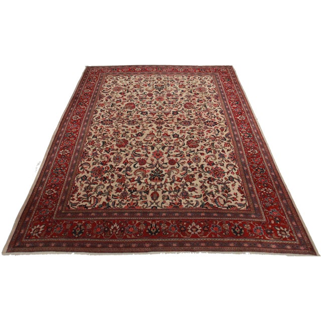 Offered is this vintage Persian Mahal rug. Made of hand-knotted wool. Features an ornate floral design.