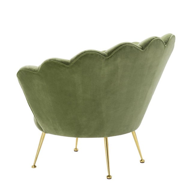 This green shell shaped chair from Eichholtz comes with fun sea shell shaped back and brass legs and can transform a room...