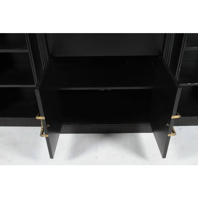 Hollywood Regency credenza, in three separate pieces, with two demilune bookcases at each side, with a center fall front...
