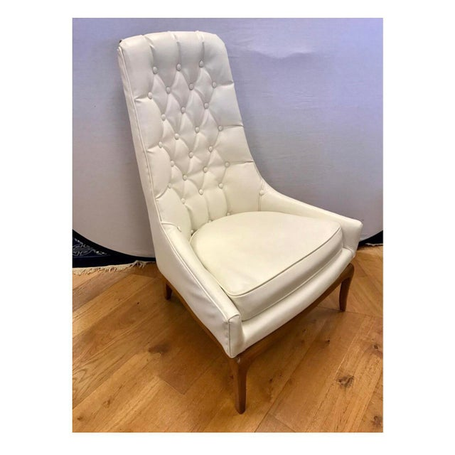 Pair of Widdicomb button tufted chairs done in a white faux leather that looks like the original fabric from the 1950's...