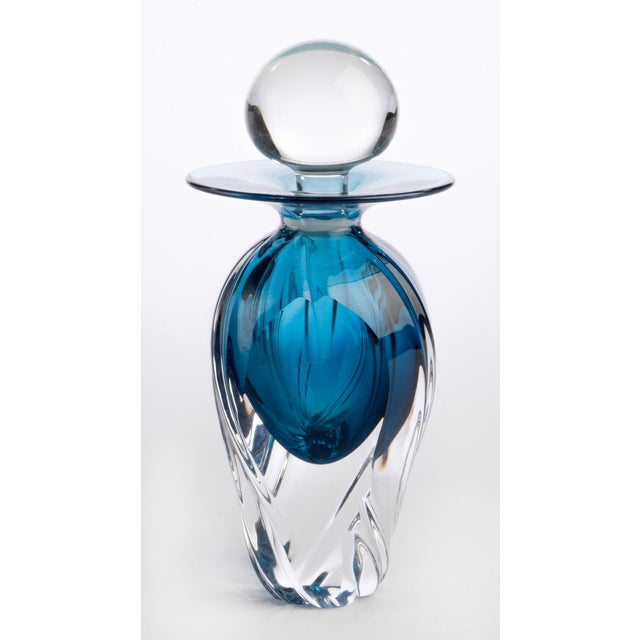 Murano style bottle that is signed by the artist. Made in 2005. This studio glass bottle is ornamental, but essentially it...