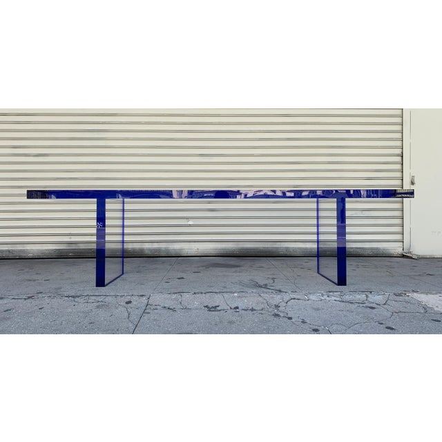 """2 available for immediate delivery. Stunning 2"""" thick deep blue and clear Lucite bench. The bench is a new addition to our..."""