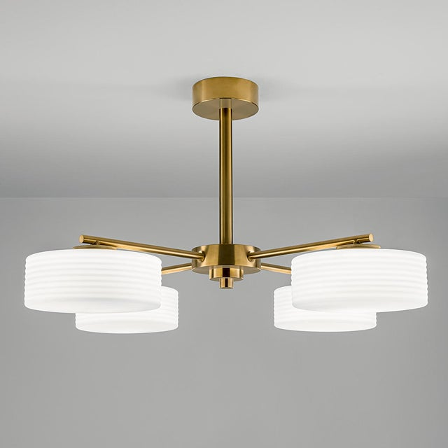 Brushed brass light with frosted opal glass. The glass shade is heavily ribbed and secured with metal threads to the...