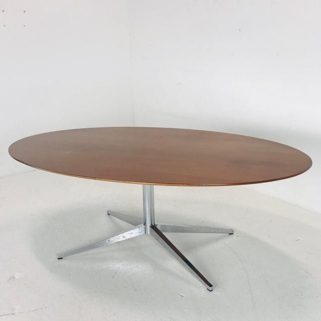 Florence Knoll dining table or desk or conference table. Top is walnut with beveled edges