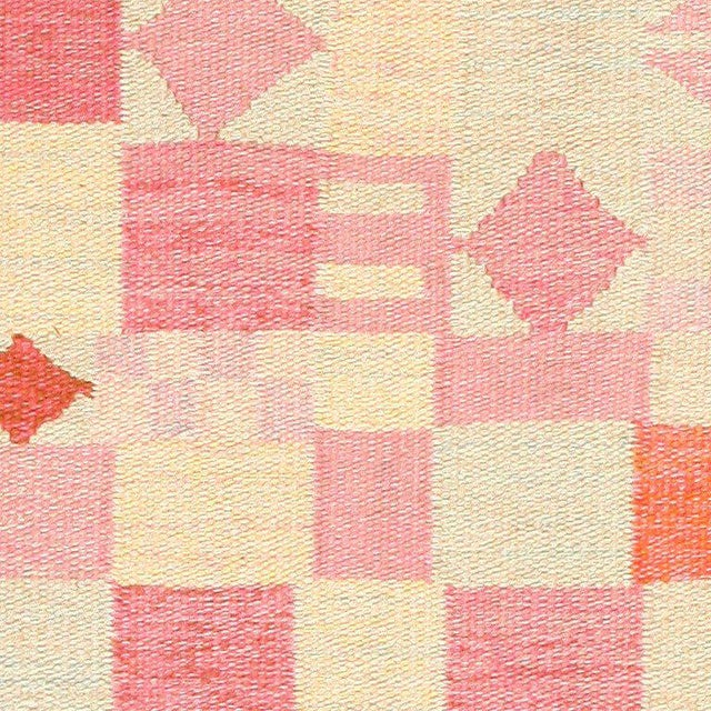 Vintage Scandinavian Swedish Kilim, circa mid-20th century, vividly toned geometric shapes define this delightful,...