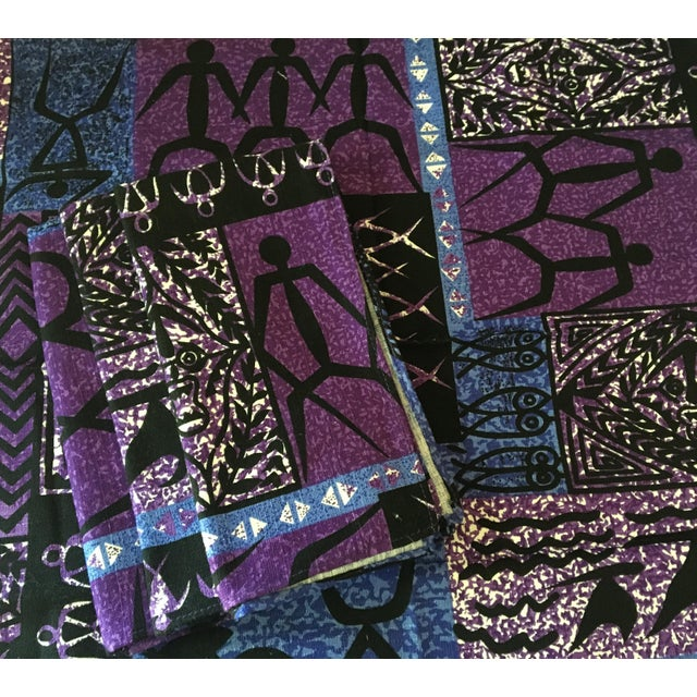 A set of four (4) blue, black and purple batik printed cotton/linen dinner napkins. Dimensions are 17 inches x 17.5 inches...