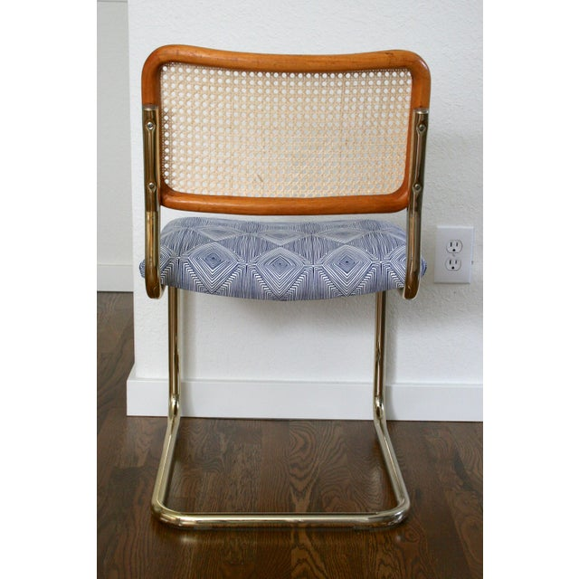 Boho Chic Brass Cantilever Cane and Blue Print Upholstered Chairs For Sale - Image 3 of 9