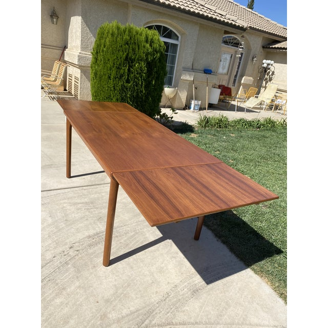 Refinished teak dining table, both ends slide in for a smaller look and easy storage. In perfect condition. Such a...