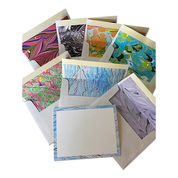 For the Well-Dressed Desk! Hand-marbled designs border each card with matching lined envelopes. Each pack contains eight...