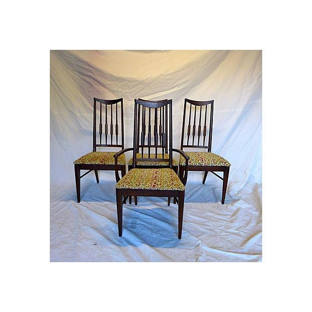 This is a set of four circa 1950s Mid-Century Modern 'reed' backed chairs with their original upholstery. There are three...