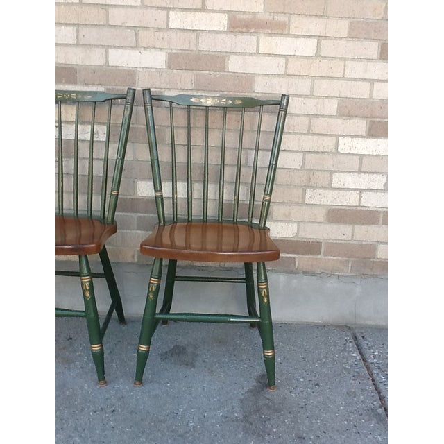 4 Fabulous Hitchcock Windsor Stick-Back stenciled chairs. All feature the traditional Hitchcock trademark. Rich green and...