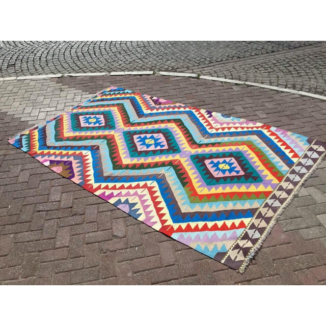 This beautiful, vintage, handwoven Kilim is approximately 60 years old. It is handmade, of very fine quality wool, cotton...